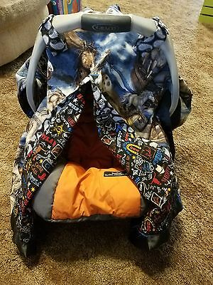 Western car seat cover. Satin binding and pearl snaps closers.