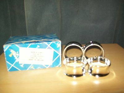 Four Silver Plated Napkin Rings in box