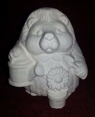 Ceramic bisque Hedgehog with flower. approx. 100mm. To glaze or paint