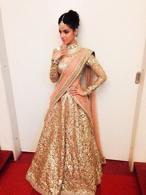 "Sabyasachi peach and gold bridal lehenga (5""2 height, size 2 US, 34"" bust)"