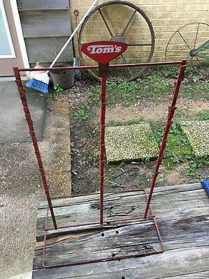 "Vintage TOM'S Red Metal Chip Display Rack - 24 3/4"" tall."