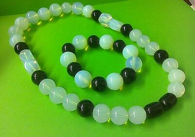 Vintage Uranium Glass Beads Strand White/ Clear on clear stretchy thread