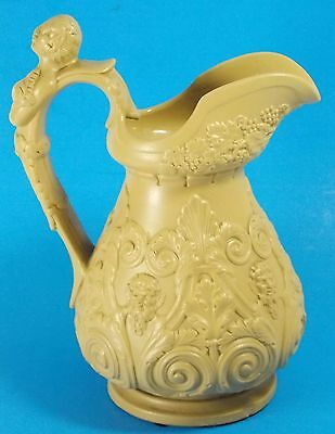 Antique Stoneware Embossed Yellow Ware Pitcher Features Pan or Bacchus Mythology