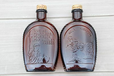 2 VINTAGE LOG CABIN SYRUP AMBER GLASS BOTTLES STATUE of LIBERTY / RUSHMORE