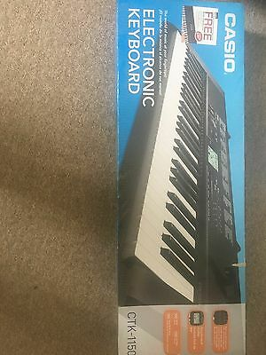 Casio CTK 1150 electronic keyboard with stand