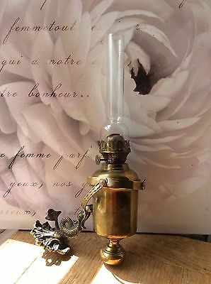 Superb Vintage ships brass gimbal oil lamp. Weighted. Dolphin bracket