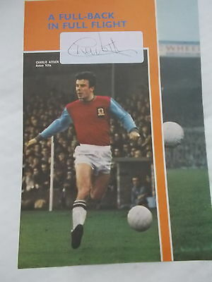 An Original Signature of CHARLIE AITKEN  inlaid on A page of A Football Annual