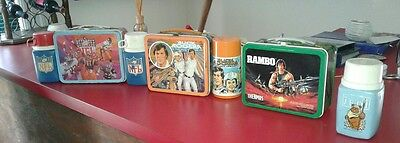 Lot of vintage lunch boxes NFL Buck Rogers Rambo And Empire Strikes Back Thermos