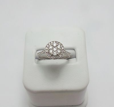 9ct WHITE GOLD 1/2 CT DIAMOND CLUSTER RING VALUED @$ 1869 COMES WITH VALUATION