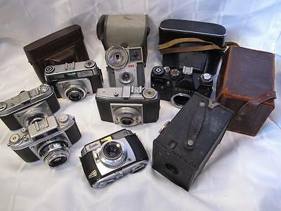 A Collection of 8 Cameras for Display or Repair