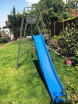 Climbing frame with slide and swing