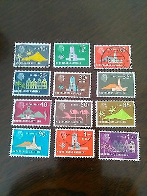 12 USED STAMPS OF NETHERLANDS FROM 10c - 1&HALF gld