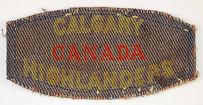 CALGARY/CANADA/HIGHLANDERS WW2 Printed Shoulder Title Badge