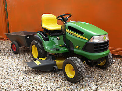 John Deere X140 automatic ride on mower, Small compact tractor, tipping trailer.