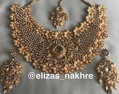 Bollywood Style Peach and Gold necklace set With Earrings And Tikka