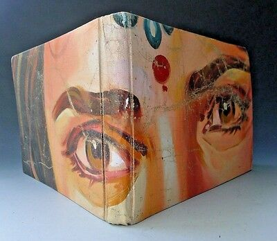 Vintage photo album or scrapbook covered in Bollywood Indian canvas poster