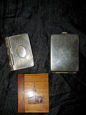 Three Vesta cases One silver plated, one white metal, & matches. One wood/Treen