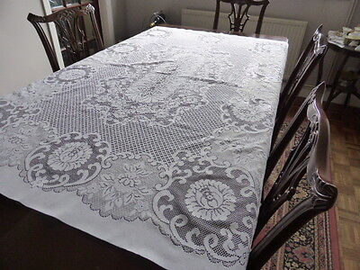 Large white rectangular lace table cloth.