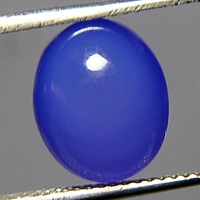 A PAIR OF 12x10mm OVAL CABOCHON-CUT NATURAL AFRICAN DEEP-BLUE ONYX GEMSTONES