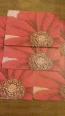 6 placemats. Red flower.
