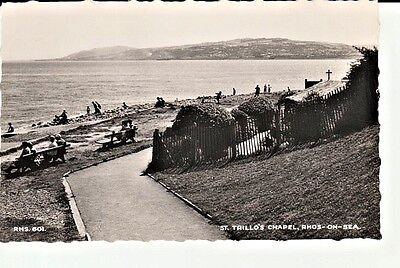 RP Early RHOS-ON-SEA St. Trillo's Chapel, people on beach, on benches