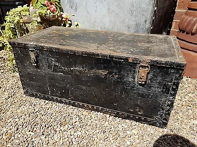 Old black industrial riveted box with metal edging