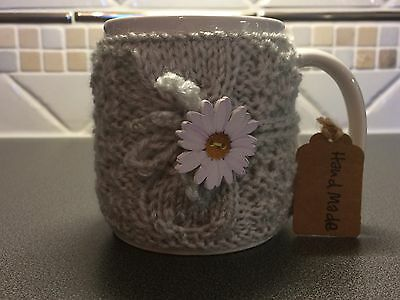 Hand Knitted Grey Mug Cosy With White Daisy Button