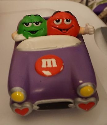 M&M Candy Dish (ceramic) in a car featuring Green and Red