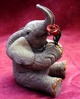 "Tuskers Elephant Figure.""love Is A Rose""."