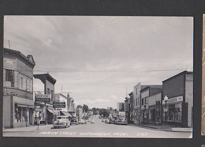 vTg 1940 River St Ontonagon MI RPPC photo postcard biz district auto signs Woody