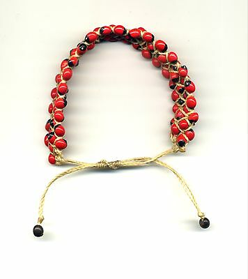 Peru Andes: Stretch Bracelet with native wayruros seeds accent on red