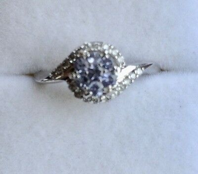 Tanzanite and diamond ring in white 9ct Gold size N