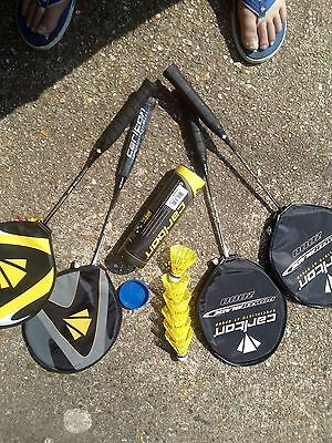 four badminton racquets and cocks