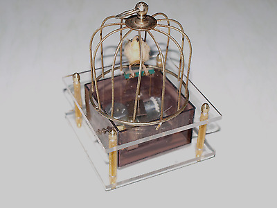 Vintage music box automaton bird dancing in a cage to theme from love story