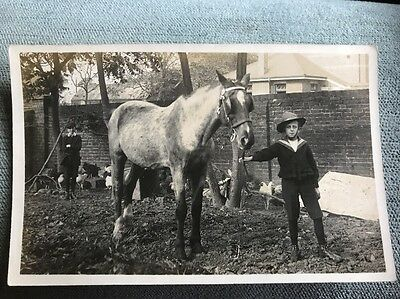 Social History scene Rochford Kent of a boy holding the reigns horse