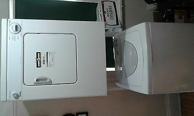 Kenmore Washer and dryer set + white rack.