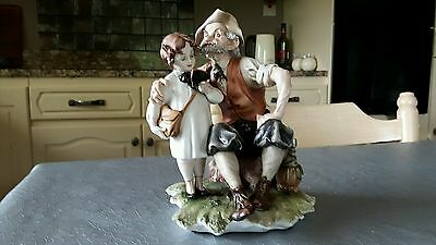 capodimonte figurine of an old man grandfather with a boy