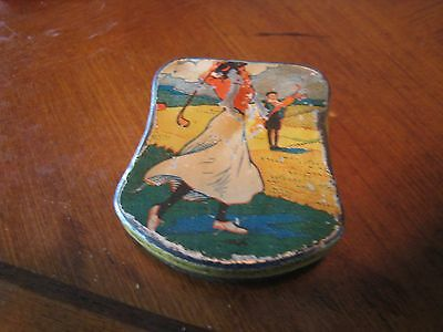 A 1910's sewing tin with lady golfer in period dress swinging a golf club