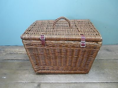 Wicker picnic basket with red leather straps