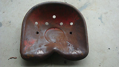 Antique steel tractor seat in good condition,  off old tractor