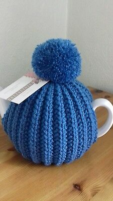 Beautiful hand knitted tea cosy 30%wool.