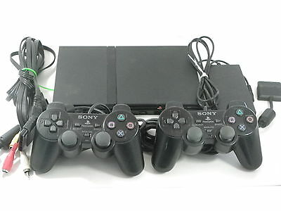 Sony Slim Playstation 2 system set with 10 games, 2 controllers and multi pack