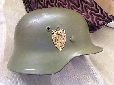 WW11 German Helmet m35 original with Norwegian re-issue. Look .Excellent example