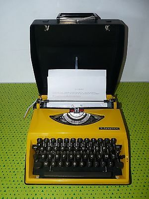 Machine à écrire portable Triumph Tippa jaune vintage TBE typewriter in case