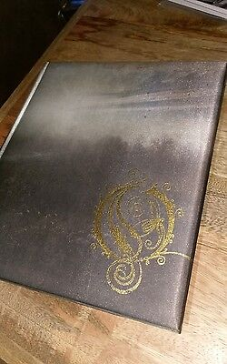 """Book of Opeth. Hardcover book with 7"""" single. Opeth"""