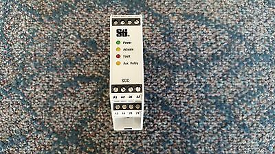 Sti Safety Relay  Part No 43872-0021  Model SCC-1DN-1224ND