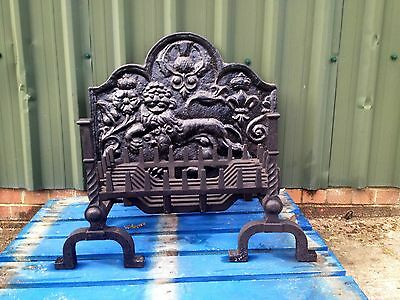 Cast Iron Fire Grate, Fire Dogs And Fireback.