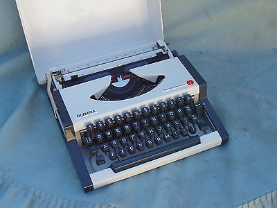 Portable Typewriter By Olympia,,with Hard Case.