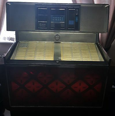 Vintage Rowe ami jukebox with 4 boxes of records.