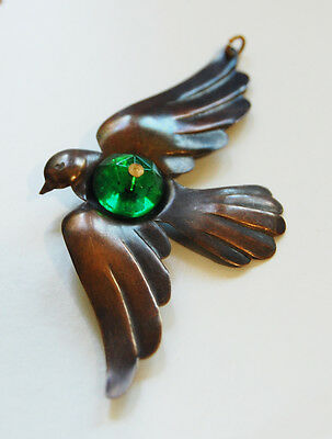 VINTAGE RAW BRASS BIRD SPARROW IN FLIGHT METAL STAMPING PENDANT w/ GREEN GLASS
